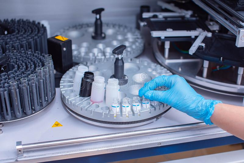 Laboratory immunoassay analyzer. Diagnosis of infectious diseases and allergic reactions. Prenatal screening. Analysis of the royalty free stock image