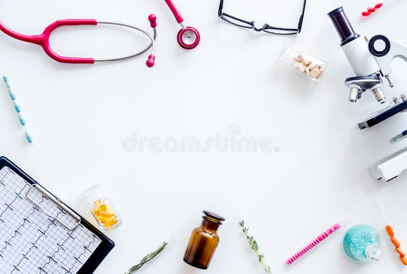 Medical tests on work table of doctor with microscope, cardiogram, test tube on white background top view copyspace. Laboratory. Medical tests on work table of stock photo