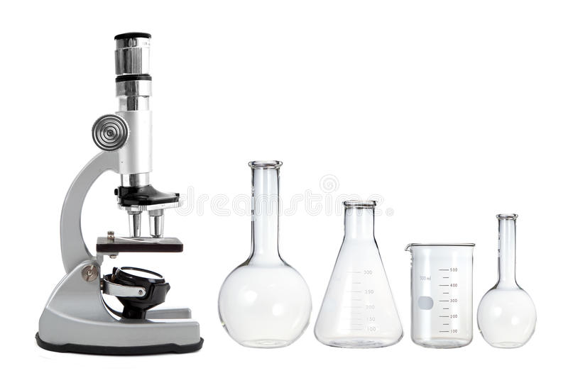 Laboratory metal microscope and empty test tubes isolated on white stock photo