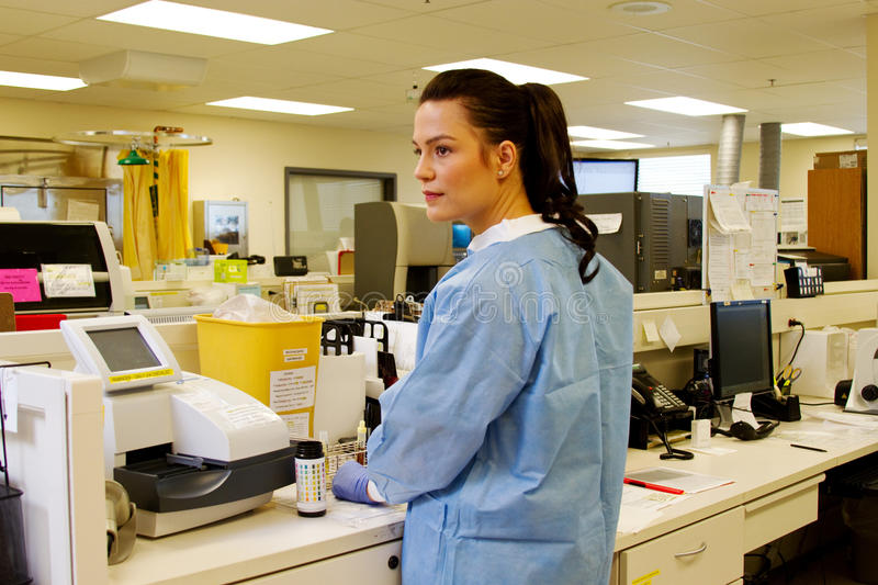 Laboratory technician looks up from work stock images