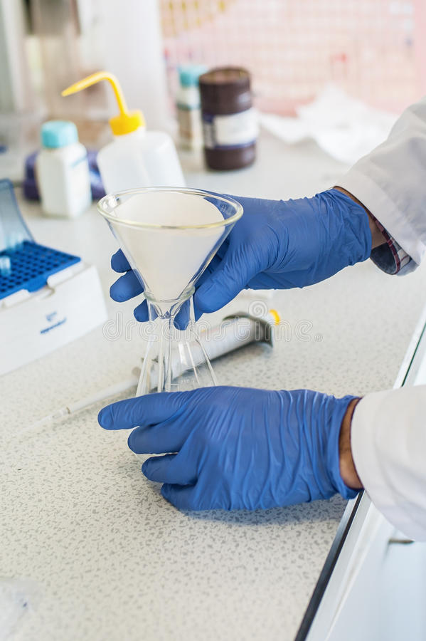 Laboratory technician performs tests. Scientific laboratory technician performs tests. Macro shot stock images