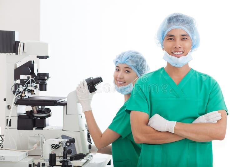 Laboratory technicians. Portrait of two laboratory technicians royalty free stock images