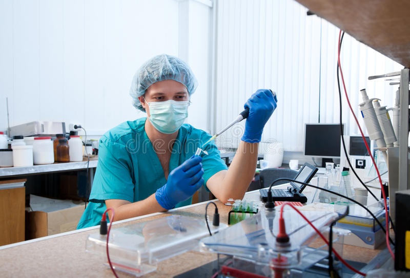 Laboratory test. Scientist doing DNA test in modern laboratory stock images