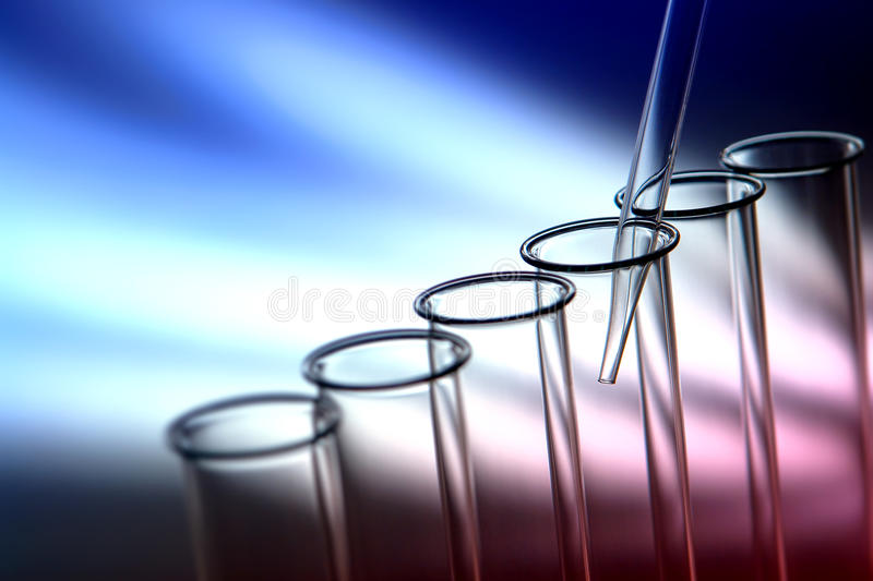 Laboratory Test Tubes in Science Research Lab. Laboratory pipette inside empty glass test tubes for a scientific experiment in a science research lab stock photography