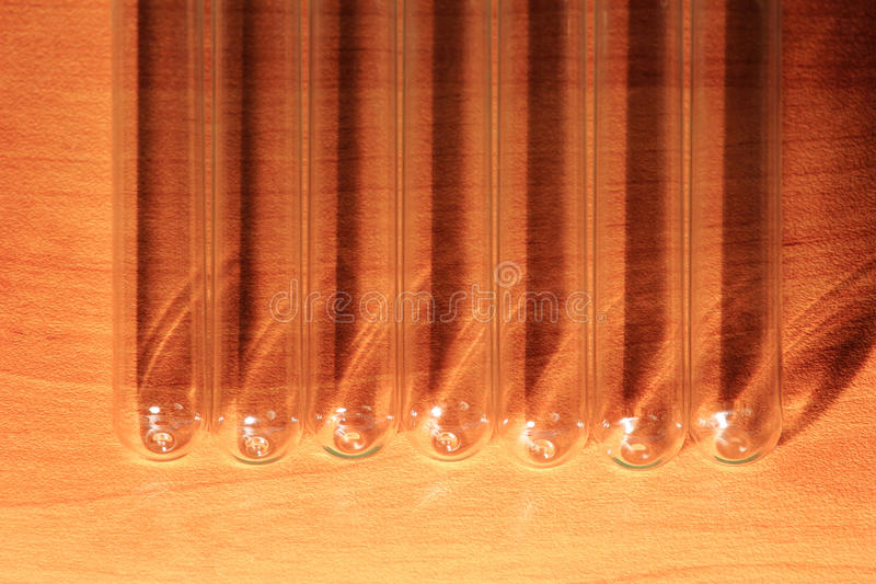 Laboratory Test Tubes, Vials, on wood background stock photos