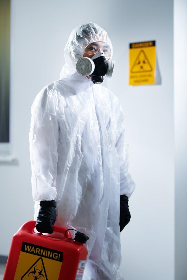 Laboratory worker in biohazard suit stock photos
