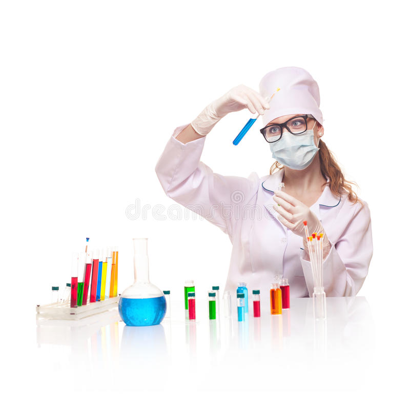 Laboratory worker selecting flasks royalty free stock image