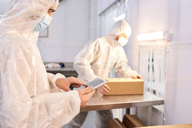 Laboratory Workers Wrapped up in Work royalty free stock photography