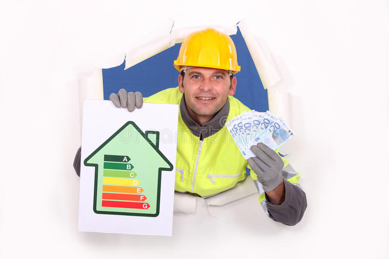 Laborer with energy rating sign royalty free stock photos