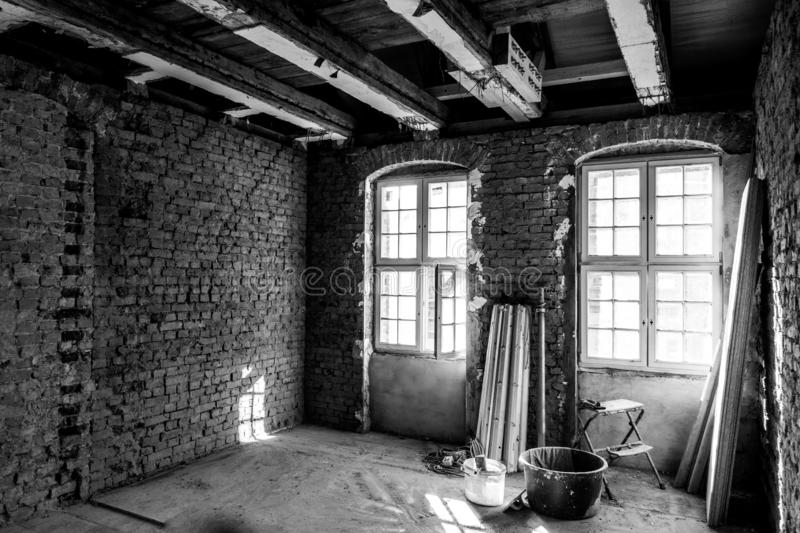 Laborious work an old house is restored. In laborious work an old house is restored royalty free stock photo