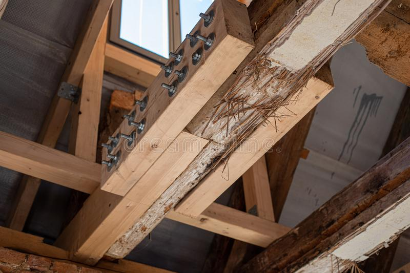 Laborious work an old house is restored, whereby old beams are strengthened with new ones. In laborious work an old house is restored, whereby old beams are royalty free stock photography