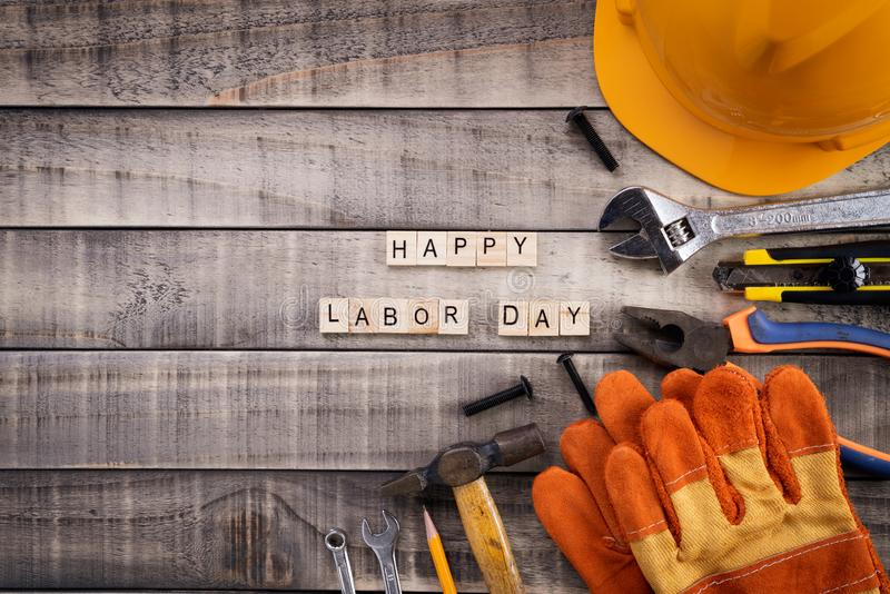 Labour Day, Wooden Block calendar with many handy tools on wooden background texture stock photography