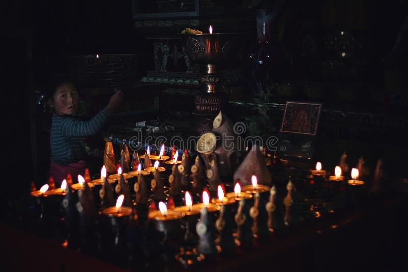 young pilgrim girl making a donation at a tibetan buddhist temple royalty free stock images