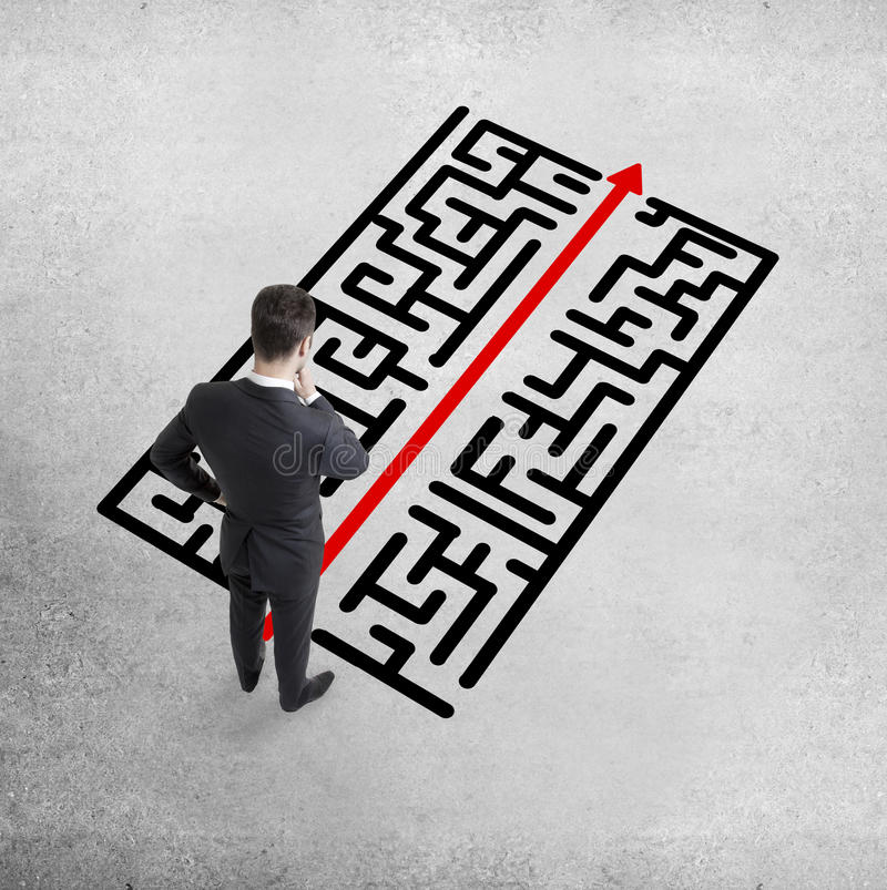 Labyrinth. Businessman standing and looking at labyrinth stock photography