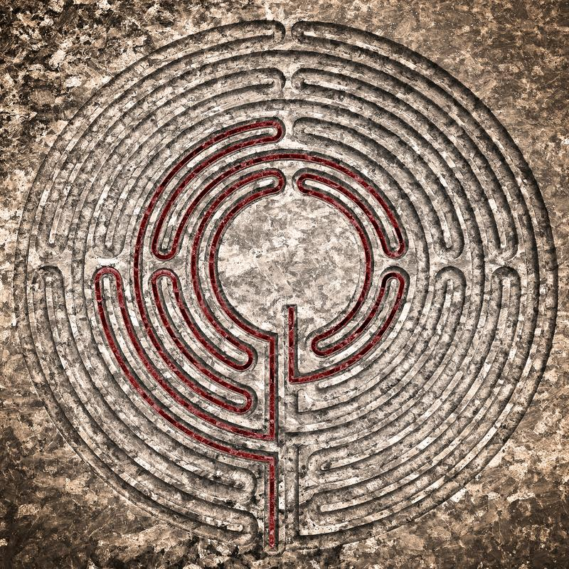 Labyrinth carved on stone - solution concept with path showing labyrinths end royalty free stock photography