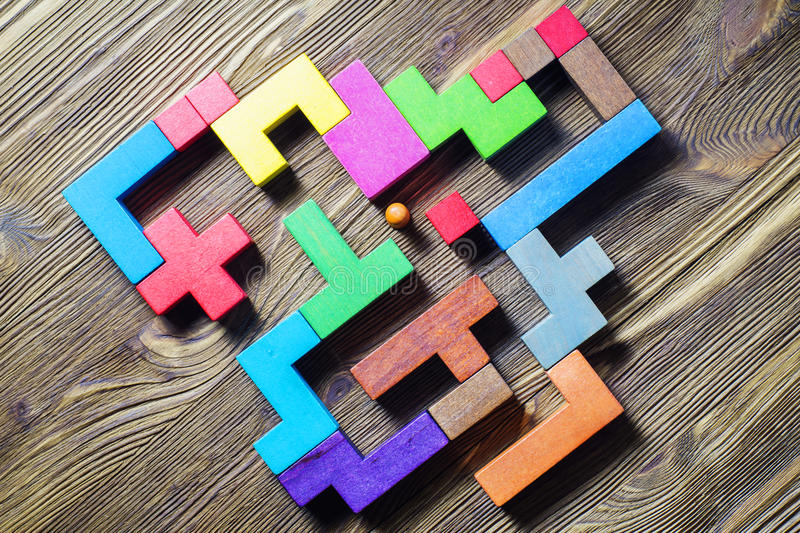 Labyrinth of colorful wooden blocks, tetris, top view. stock photo