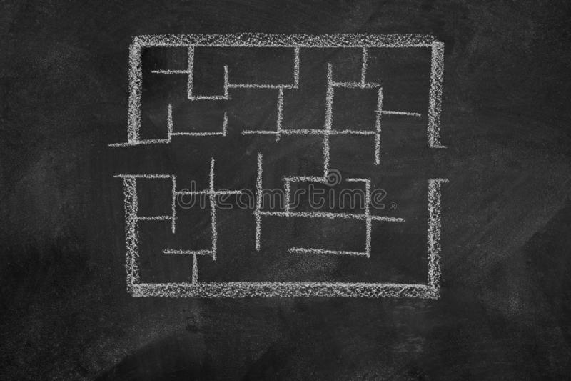 Labyrinth drawing on background. Slate with labyrinth drawing on background royalty free stock image