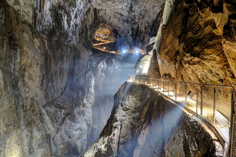 Labyrinthine, illuminated walkways inside Skocjan Caves, one of. Divača, Slovenia - 10 July 2017: The Skocjan Caves system, on July 10, 2017 in Divača stock photos