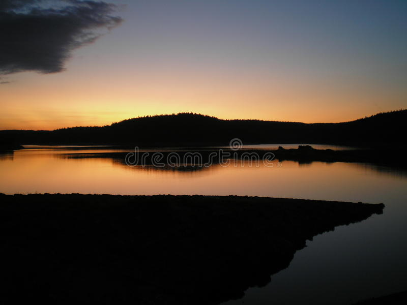 Lac sunset photographie stock