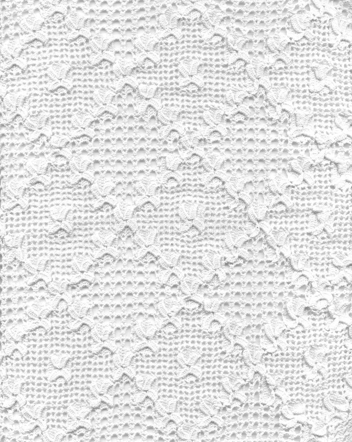 Lace. Handmade white lace with light background. This image is very fine also horizontally rotated
