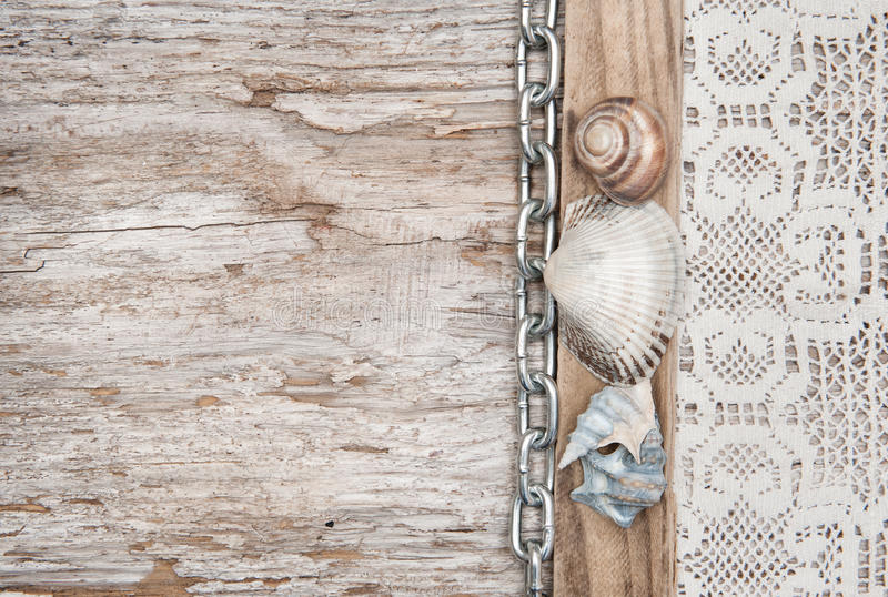 lace fabric with chain and seashells on old wood stock. Black Bedroom Furniture Sets. Home Design Ideas