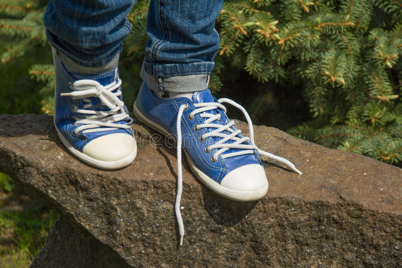 The lace on one Shoe was untied stock photos