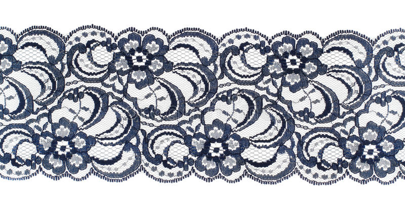 Lace trim ribbon over white. Fabric. Closeup. Lace trim ribbon over white. Embroidered fabric. Closeup royalty free stock photo