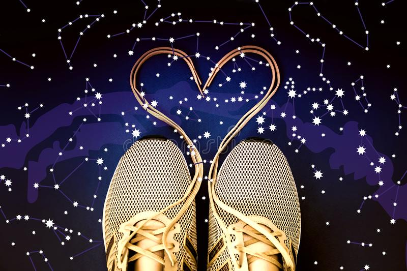 Laced sneaker heart. Constellations, star map. Science astronomy, star map on a blue background, the starry sky. Horoscope. Laced sneaker heart. Constellations stock image