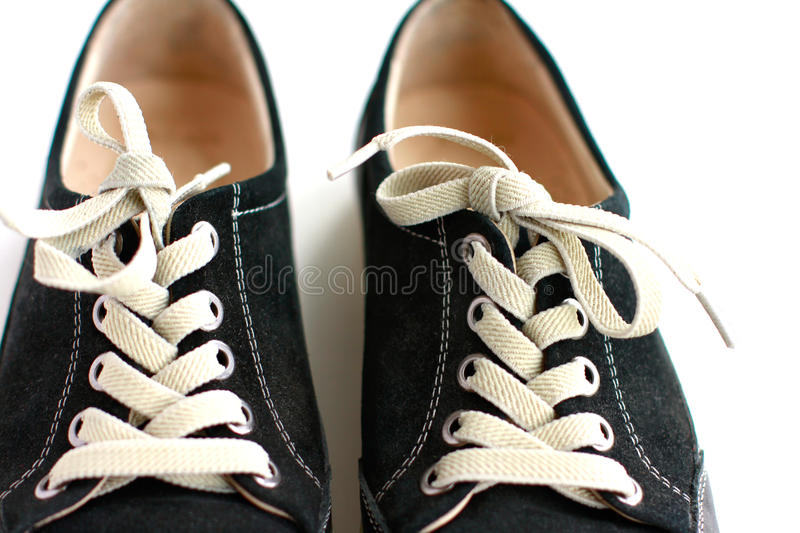 Laced up sneakers closeup. Laced up sneakers on white background stock photography