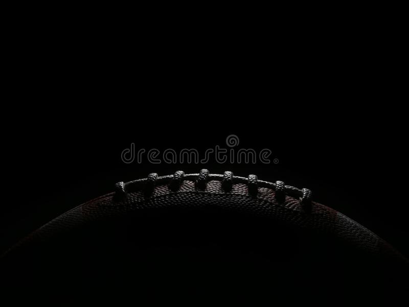 Laces of an American Football Game Ball Lit from Overhead stock photography