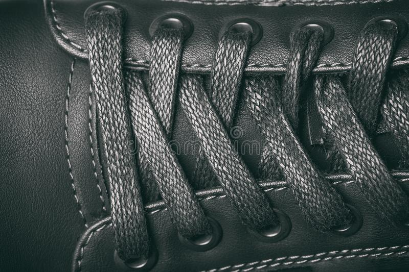 Laces on a black leather boot. Top view. A picture with a small royalty free stock photos