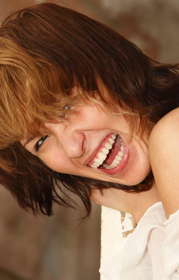 Lachen des jungen Mädchens stockfotografie