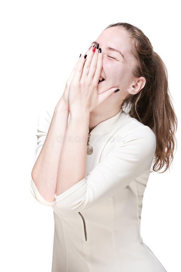 Lachend jong meisje in een witte kleding stock foto's