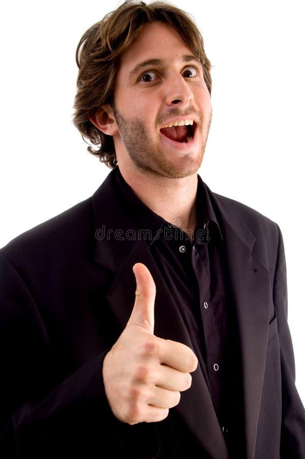 Lachend mannetje met omhoog duimen royalty-vrije stock afbeelding