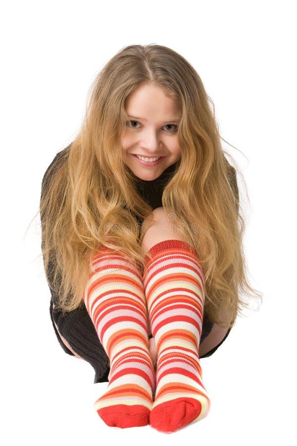Lachend meisje in grappige sokken royalty-vrije stock foto