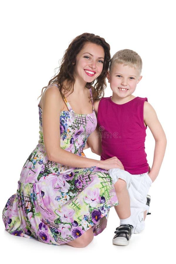Lachend weinig jongen en zijn moeder stock foto's