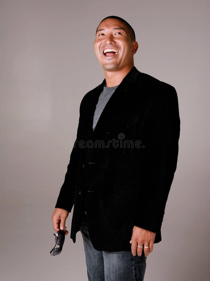 Lachende Aziatische Mens stock afbeeldingen