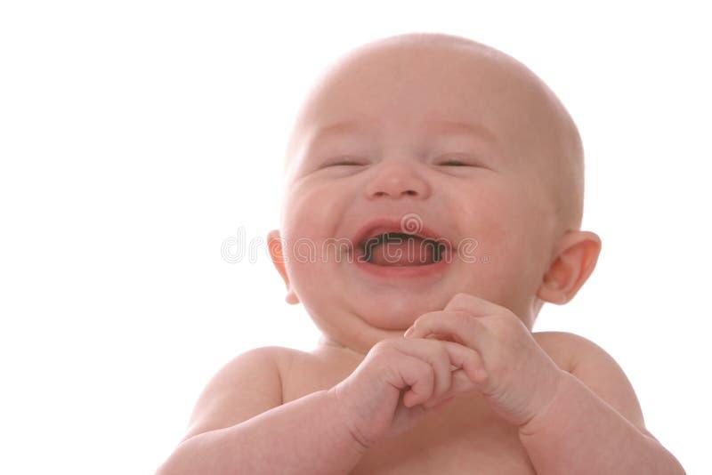 Lachende baby op deken stock foto