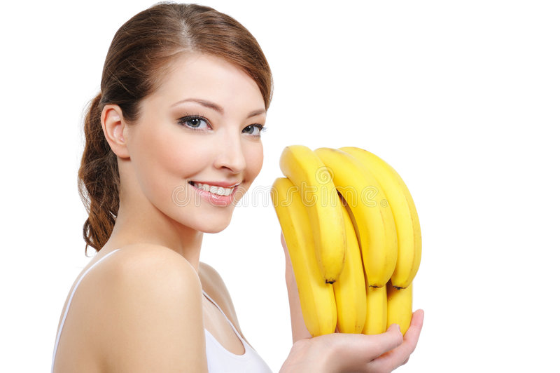 Lachende Frau mit Bananen stockfotos