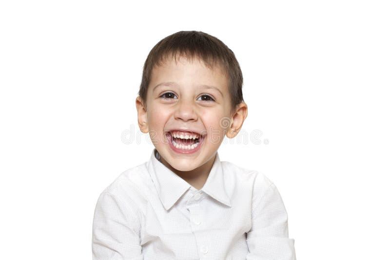 Lachende Jongen op Witte Achtergrond stock afbeelding