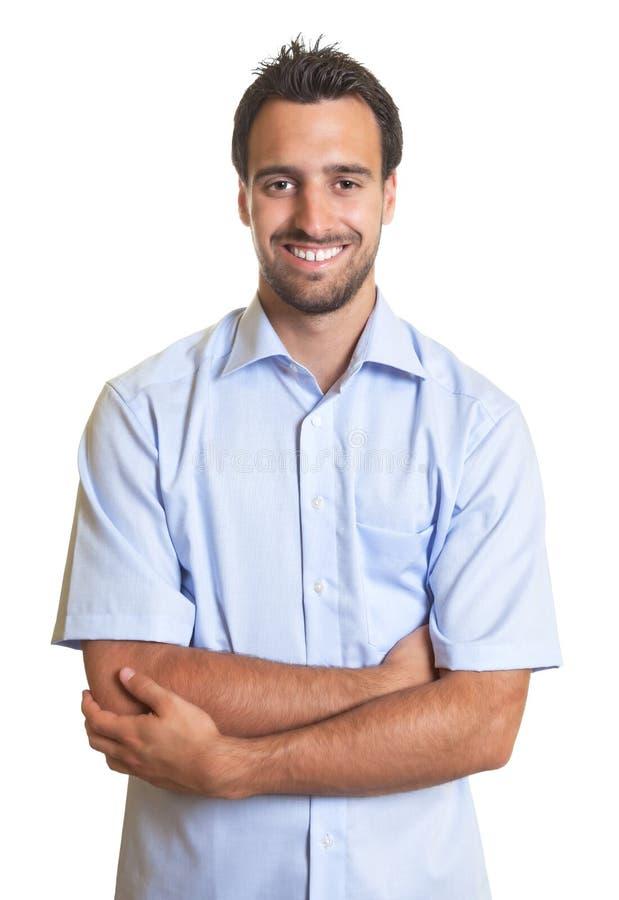 Lachende Latijnse mens in een blauw overhemd royalty-vrije stock afbeeldingen