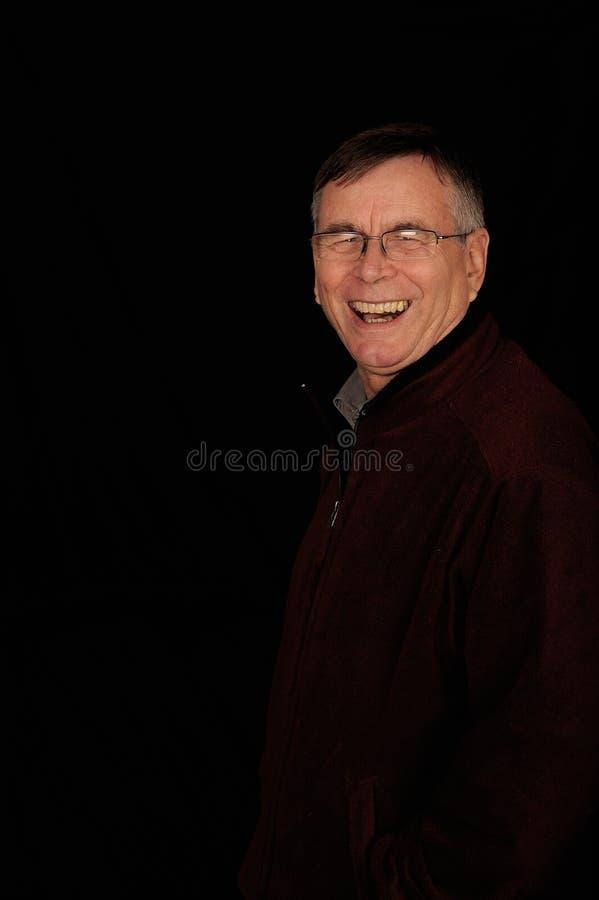Lachende rijpe mens stock afbeeldingen