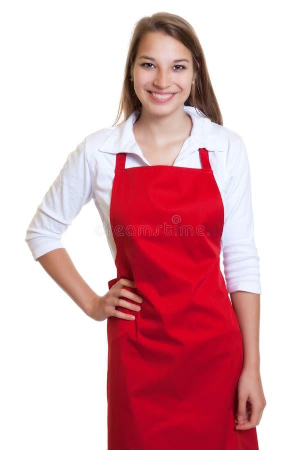 Lachende serveerster met rode schort royalty-vrije stock afbeelding