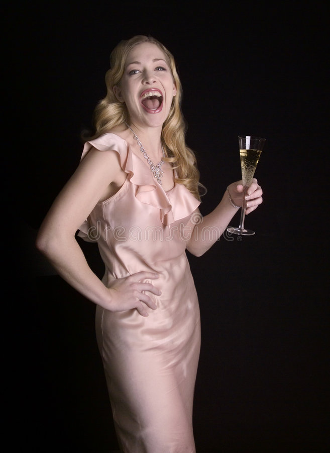 Lachende vrouw met champagneglas stock foto's
