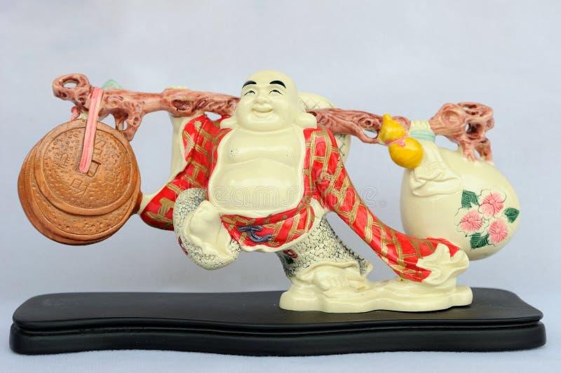 lachender Buddha mit Münzen stockfotos