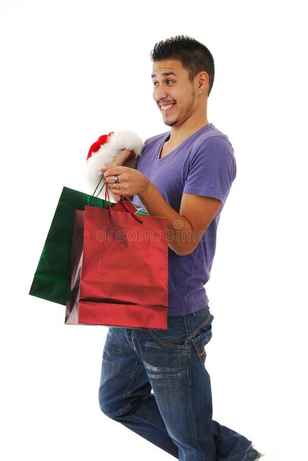 Lachender Mann mit Weihnachtsgeschenken lizenzfreie stockbilder