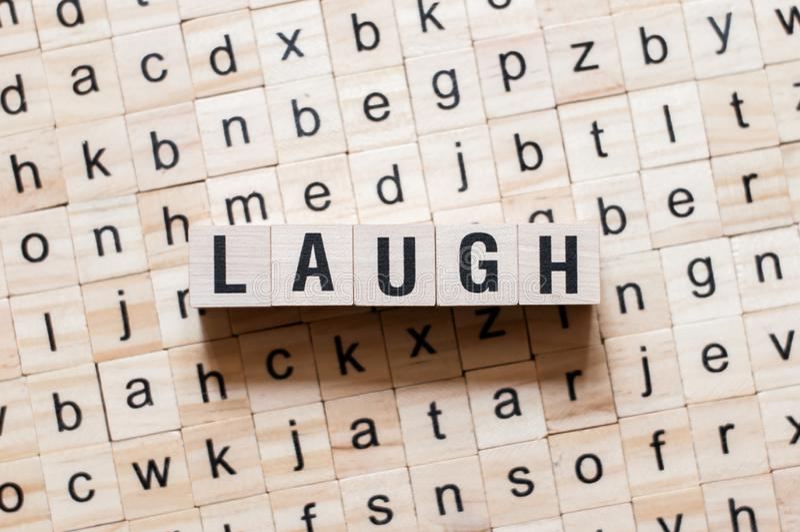 Lachenwortkonzept lizenzfreie stockbilder
