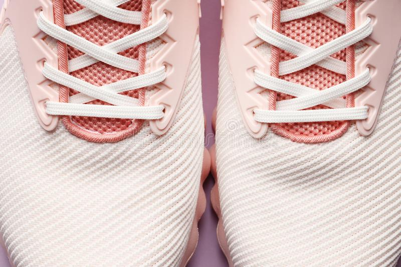 Pink women sneakers royalty free stock photo