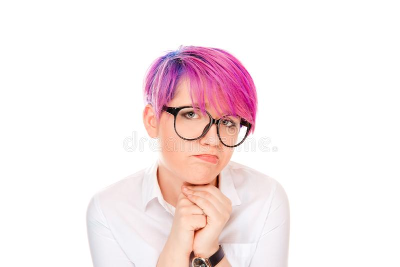 Lack of confidence. Shy young woman feels awkward. Isolated on white wall background. Millennial model with pink magenta hair. Human emotions, face expressions royalty free stock images