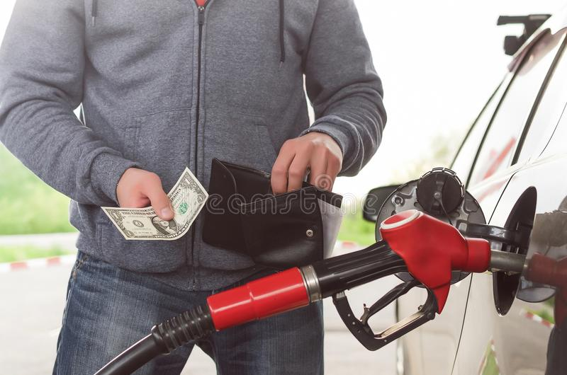 Expensive fuel. Not enough money for gasoline. royalty free stock images